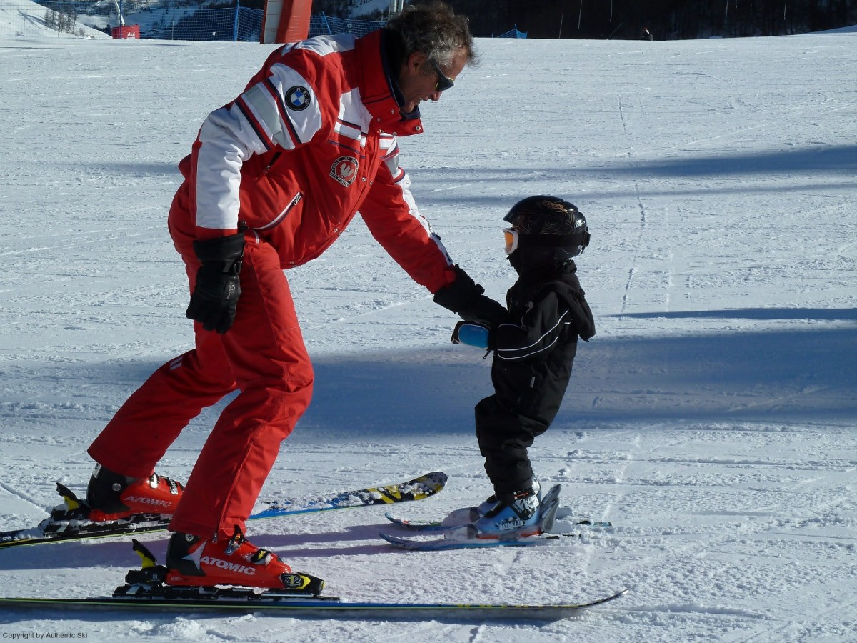 Ski teaching a small child in Val d'Isère